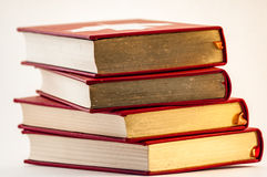 Pile of old golden and red books royalty free stock images