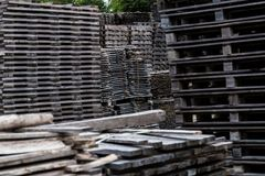 Pile of old and gray timber planks. Stack of old wooden planks Stock Photos