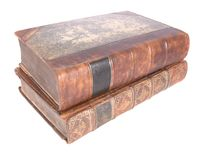 Pile of old leather bound books Stock Photo