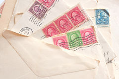 Pile of old letters, envelopes post stamps Royalty Free Stock Images
