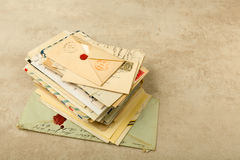 Pile of old letters. Old envelopes and letters stacked in a bundle Royalty Free Stock Image