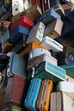 Pile of old luggage. Pile of various styles of old luggage at airport or train station Stock Images