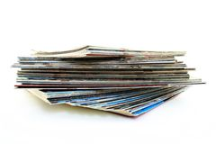 Pile of old magazines. On white background Royalty Free Stock Photo