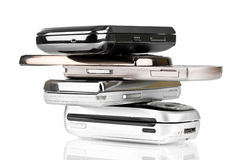 Mobile phones over. Pile of old mobile phones over a white background Royalty Free Stock Photos