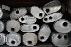 Pile of old mufflers Royalty Free Stock Photos