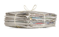Pile of old newspapers. On a white backround Royalty Free Stock Photography