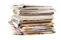 Pile of old newspapers and magazines, stacked, isolated on white background Royalty Free Stock Photography