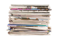 Pile of old newspapers and magazines, stack, side view, isolated on white background Royalty Free Stock Images