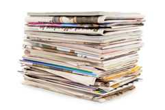 Pile of old newspapers and magazines isolated on white background Royalty Free Stock Photo