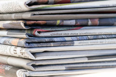 Pile of old newspapers Stock Photo