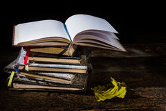 Pile of old notebooks. On wooden table royalty free stock photos