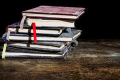 Pile of old notebooks. On wooden table royalty free stock photo