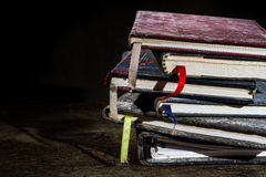 Pile of old notebooks. On wooden table stock photo