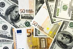 A pile of one hundred dollars USD and fifty euros EUR background close. Money and financial concept.  royalty free stock photography