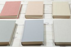 Pile of old pastel colors books stacked. Pile of old books pastel colors stacked. Selective focus with copy space Stock Image
