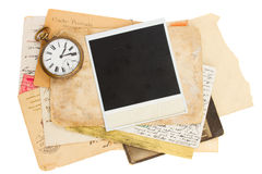 Pile of old photos with antique clock Stock Photo