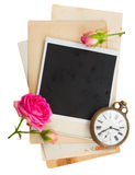 Pile of old photos with antique clock, key and Stock Photo