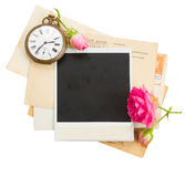 Pile of old photos with antique clock, key and Royalty Free Stock Photos