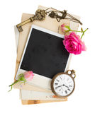 Pile of old photos  with antique clock, key and roses Stock Photography