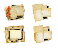 Pile of old photos and letters with bouquet of dried roses on wh Royalty Free Stock Photo