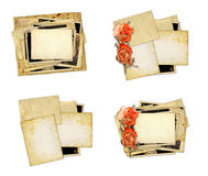 Pile of old photos and letters with bouquet of dried roses on wh Stock Photo