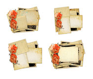 Pile of old photos and letters with bouquet of dried roses on wh Royalty Free Stock Image