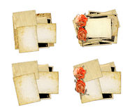 Pile of old photos and letters with bouquet of dried roses on wh Royalty Free Stock Images