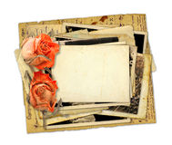Pile of old photos and letters with bouquet of dried roses Stock Photos