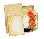 Pile of old photos and letters with bouquet of dried roses Stock Photography