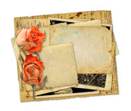 Pile of old photos and letters with bouquet of dried roses Royalty Free Stock Images