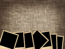 Pile of old photos on linen background Royalty Free Stock Photos