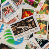Pile of old random used postage printed stamps from various countries and different time, square. For pattern, wallpaper Royalty Free Stock Images