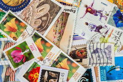 Pile of old random used postage printed stamps from various countries and different time Stock Image