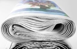 Pile of old rolled up newspapers Royalty Free Stock Image