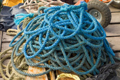 A pile of old ropes on a jetty in the tropics Stock Photos
