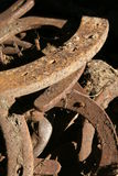A pile of old rusty horse shoes Royalty Free Stock Image