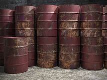Pile of old rusty metal barrels. In old storehouse stock image