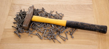 Pile of old screws and a hammer Stock Photography