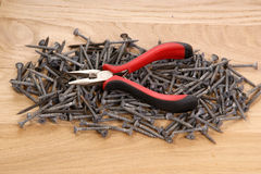 Pile of old screws and pliers Royalty Free Stock Photos