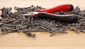 Pile of old screws and pliers Stock Image