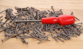 Pile of old screws and pliers Royalty Free Stock Photo