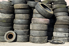 A pile of an old second hand car tires stacked Stock Images