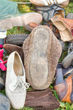 Pile of old shoes stock images