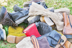 Pile of old shoes royalty free stock photo