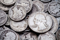 Pile of old Silver Dimes & Quarters 2. A pile of old circulated worn collectible Mercury and Roosevelt silver dimes and silver Washington quarters. Could be used Royalty Free Stock Photography
