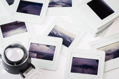Pile of old slide with the loupe Stock Photo