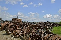 Pile of old steam engines wheels for salvage. Piles of old steam engine rims and steel wheels are stacked in a salvage and recycling yard Royalty Free Stock Image