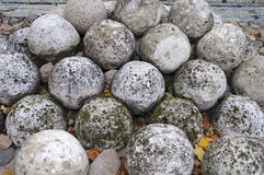 Pile of old stone cannonballs Royalty Free Stock Photography