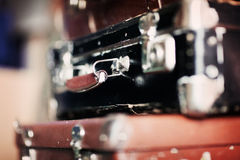 A pile of old suitcases. Old worn suitcases and carpet bags Stock Images