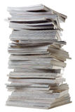 Pile of old thick magazines. The big pile of thick glossy magazines on white background Royalty Free Stock Photography